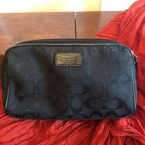 Coach makeup bag - black with red lining